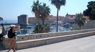 Tourist is taking a panorama photo of Dubrovnik in Croatia
