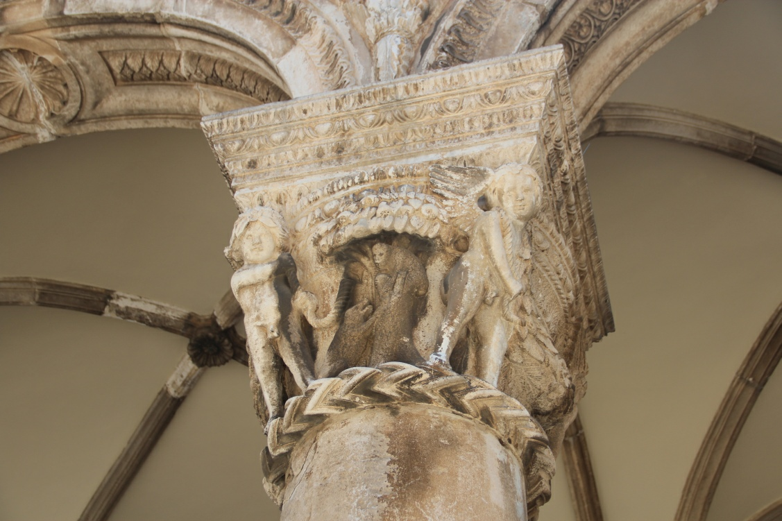Close up photo of an engraved stone master piece, decorated column in front of the Rectors Palace in Dubrovnik